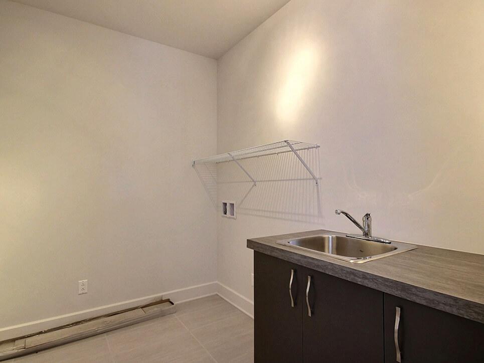 salle de lavage via blainville construction neuve projet immobilier rive nord condo